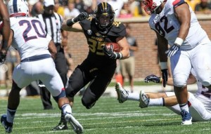 Tyler Hunt runs over and through the UConn defense for a big gain (photo/Mizzou Athletics)