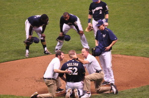 Jimmy Nelson tended to by Brewers training staff, after being hit in the head by a line drive. (photo/Wisconsin Radio Network)