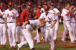St. Louis Cardinals Seth Maness throws Brandon Moss to the ground after Moss hit a three run walk off home run to defeat the Washington Nationals in the ninth inning at Busch Stadium in St. Louis on September 1, 2015. St. Louis won the game 8-5.  Photo by Bill Greenblatt/UPI
