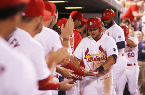 St. Louis Cardinals Jhonny Peralta is welcomed into the dugout by teammates after hitting a three run home run in the fourth inning against the Milwaukee Brewers in the third inning at Busch Stadium in St. Louis on September 24, 2015.    Photo by Bill Greenblatt/UPI