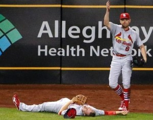 Peter Bourjas calls to the dugout after he collided with Stephen Piscotty (photo/MLB)