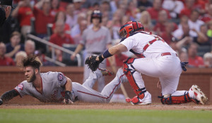 Washington Nationals Bryce Harper slides past the late tag by St. Louis Cardinals catcher Yadier Molina for a run in the first inning at Busch Stadium in St. Louis on August 31, 2015.  Photo by Bill Greenblatt/UPI