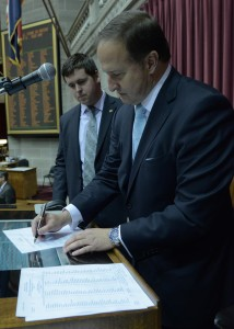 Representative Scott Fitzpatrick watches as former House Speaker John Diehl, Junior, signs the override of Governor Jay Nixon's veto of Fitzpatrick's HB 150, reducing unemployment benefits in Missouri.  (photo courtesy; Tim Bommel, Missouri House Communications)