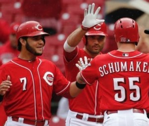 Skip Schumaker is greeted at home after hitting a three-run homer (photo/MLB)