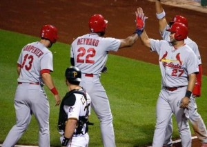Jason Heyward is greeted at home plate after his grand slam (photo/MLB)