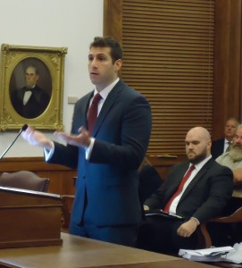 Assistant Circuit Attorney Aaron Levinson presents his argument to the Missouri Supreme Court that Amendment 5 did not grant some felons the right to have a gun, as David Roland (seated) with the Freedom Center of Missouri prepares to argue that it does.