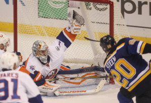 New York Islanders goaltender Thomas Greiss snags the puck off the stick of St. Louis Blues Alexander Steen during the overtime period at the Scotreade Center in St. Louis on October 24, 2015. New York won the game 3-2 in overtime.    Photo by Bill Greenblatt/UPI