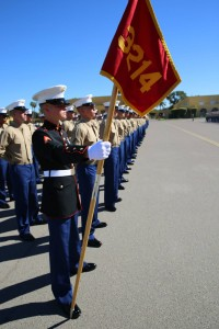 Dominic E. Schraft (foreground, holding flag) takes part in a graduation ceremony at Marine Corps Recruit Depot San Diego, November 7, 2014.