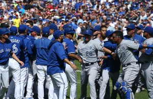 TORONTO, CANADA - AUGUST 2: Salvador Perez #13 of the Kansas City Royals is held back by teammates as both benches clear in the eighth inning during MLB game action against the Toronto Blue Jays on August 2, 2015 at Rogers Centre in Toronto, Ontario, Canada. (Photo by Tom Szczerbowski/Getty Images)