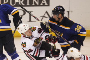 St. Louis Blues Troy Brouwer knocks Chicago Blackhawks Marko Dano to the ice during the first period at the Scottrade Center in St. Louis on October 1, 2015. Photo by Bill Greenblatt/UPI
