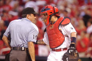 St. Louis Cardinals catcher Yadier Molina says hello to home plate umpire Phil Cuzzi before Game 1 of the National League Division Series against the Chicago Cubs at Busch Stadium in St. Louis on October 9, 2015. Molina is wearing a special splint on his index finger of his left hand after an injury.   Photo by Bill Greenblatt/UPI