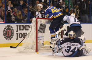 St. Louis Blues David Backes ends up nearly on top of the goal after scoring against the Winnipeg Jets in the first period at the Scottrade Center in St. Louis on November 16, 2015.  Photo by Bill Greenblatt/UPI