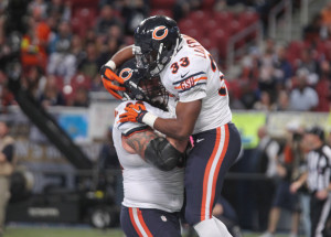 Chicago Bears Jeremy Langford jumps into the arms of teammate Matt Slauson after scoring a touchdown in the fourth quarter against the St. Louis Rams at the Edward Jones Dome in St. Louis on November 15, 2015. Chicago won the game 37-13. Photo by Bill Greenblatt/UPI