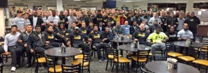 Gary Pinkel poses for a picture with coaches and members of his Missouri Football team (photo/Twitter @GaryPinkel)