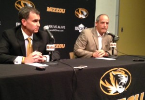 A.D. Mack Rhoades (L) and Gary Pinkel answer questions from the media.