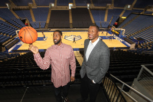Former NBA basketball players Theophalus Ratliff (R) watches as Larry Hughes tries to spin a basketball on his finger following the announcement of the the formation of the Champions League at Chaifetz Arena in St. Louis on November 17, 2015. Champions Basketball League will feature NBA players immediately upon their retirement and will feature All Stars as players and Hall of Famers as managers and coaches. An inaugural game will be held in St. Louis on January 29, 2016. Photo by Bill Greenblatt/UPI