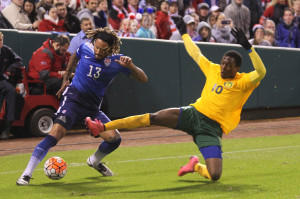 U.S.A.'s Jermaine Jones stops the ball as St. Vincent and the Grenadines Oalex Anderson dives to block in the first half at Busch Stadium in St. Louis on November 13, 2015.   Photo by Bill Greenblatt/UPI