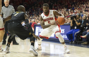 Terrence Phillips guards Arizona's Kadeem Allen. (photo/Emily Guaci, Arizona Athletics)