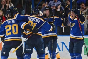 Vladimir Tarasenko is greeted by teammates Alex Steen, David Backes and Paul Stastny after his power play goal (photo/NHL.com)