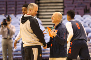 Illinois head basketball coach John Groce (R) greets Missouri head basketball coach Kim Anderson during a practice session for both teams at the Scottrade Center in St. Louis on December 22, 2015. Missouri and Illinois will play each other in the Annual Braggin' Rights game on December 23, 2015. Photo by Bill Greenblatt/UPI