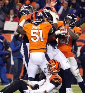 The Broncos celebrate their victory after recovering an A.J. McCarron fumble (photo/Denver Broncos-Ben Hayes)