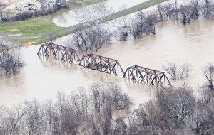 A railroad bridge is nearly covered by water from the Meramec River during historic flooding in Valley Park on December 31, 2015. Flooding statewide from three straight days of rain has caused evacuations, road closures and fourteen deaths. Photo by Bill Greenblatt/UPI