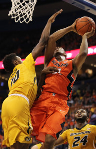 Missouri Tigers K.J. Walton tries to defend as  Illinois Illini Malcolm Hill goes in for a layup in the first half of the Annual Braggin Rights basketball game at Scottrade Center in St. Louis on December 23, 2015.  Photo by Bill Greenblatt/UPI