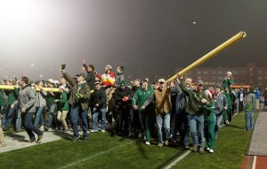 Northwest Missouri State fans storm the field and tear down the goalpost. (photo/bearcatsports.com)