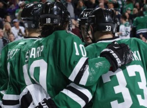Patrick Sharp (10) is congratulated by teammates after scoring in the first period (photo/NHL.com)