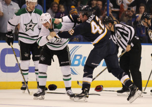 St. Louis Blues David Backes lands a punch to the face of Dallas Stars Jamie Benn in the first period at the Scottrade Center in St. Louis on December 12, 2105. St. Louis defeated Dallas 3-0.  Photo by Bill Greenblatt/UPI