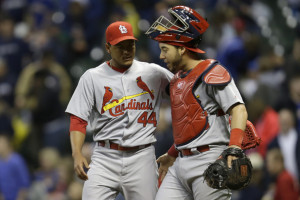 Tony Cruz (R) congratulates Carlos Martinez (file photo/MLB)