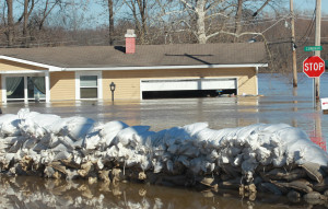 Sandbags that had no effect, sit near a home along the flooded Meramec River in Arnold, Missouri on January 1, 2016. Water has begun to receed as flooding statewide from three straight days of rain caused evacuations, road closures and fifteen deaths. Photo by Bill Greenblatt/UPI