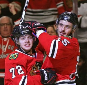 Artemi Panarin celebrates his goal with Artem Anisimov of Chicago (photo/NHL.com)