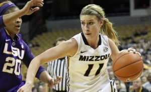 Lindsey Cunningham drives around an LSU defender (photo/Mizzou Athletics)