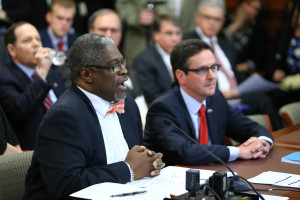 Kansas City Mayor Sly James (left) testifies against the bill offered by Senator Kurt Schaefer (right) that would repeal one-percent earnings taxes in Kansas City and St. Louis.  (Photo courtesy; Harrison Sweazea, Missouri Senate Communications)