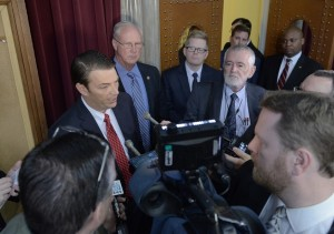 House Speaker Todd Richardson (red tie)  fields questions from reporters after the first week of the 2016 session.  (photo courtesy; Tim Bommel, Missouri House Communications)
