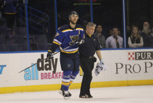 St. Louis Blues Alex Pietrangelo is helped off the ice by trainer Ray Barile after being boarded in the first period against the Buffalo Sabres at the Scottrade Center in St.Louis on November 19, 2015. St. Louis won the game 3-2 in a shootout. Photo by Bill Greenblatt/UPI