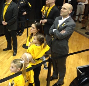 Mizzou coach Brad Loos along with his wife Jen and three daughters watch a video tribute at halftime