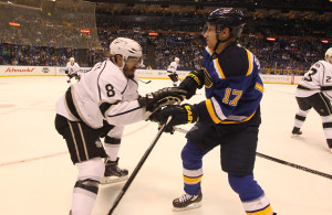 St. Louis Blues Jaden Schwartz and Los Angeles Kings Drew Doughty tie up in the first period at the Scottrade Center in St. Louis on February 18, 2016.   Photo by Bill Greenblatt/UPI
