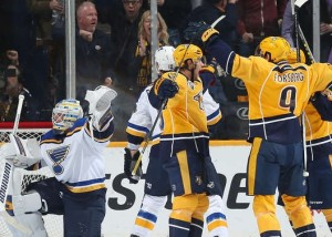 Filip Forsberg celebrates a goal while Jake Allen protests (photo/NHL.com)