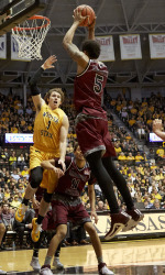 Feb 18, 2016; Wichita, KS, USA; Missouri State Bears forward Obediah Church (5) pulls down a rebound in front of Wichita State Shockers guard Evan Wessel (3)  at Charles Koch Arena. Mandatory Credit: Gary Rohman/MLS/USA TODAY Sports