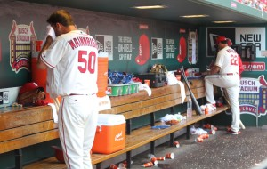 St. Louis Cardinals pitcher Adam Wainwright wipes his face in the dugout after coming out of the game while manager Mike Matheny makes a pitching change in the sixth inning against the Cincinnati Reds at Busch Stadium in St. Louis on April 16, 2016.   Photo by Bill Greenblatt/UPI