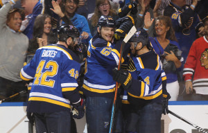 St. Louis Blues Colton Parayko (55) is mobbed by teammates after scoring a goal in the first period against the Chicago Blackhawks at the Scottrade Center in St. Louis on April 25, 2016. Photo by Bill Greenblatt/UPI