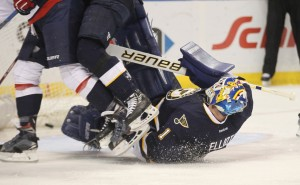 St. Louis Blues Brian Elliott gets trampled in the second period during a goal by the Washington Capitals at the Scottrade Center in St. Louis on April 9, 2016. Washington defeated St. Louis 5-1. Photo by Bill Greenblatt/UPI