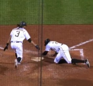Gregory Polanco slaps home plate after scoring the winning run