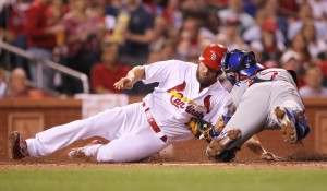 St. Louis Cardinals Matt Holliday is tagged out at home plate by Chicago Cubs catcher Miguel Montero in the fourth inning at Busch Stadium in St. Louis on April 19, 2016. Holliday tried to score from third base on a sacrifice fly ball by Yadier Molina.  Photo by Bill Greenblatt/UPI