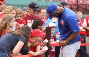Former St. Louis Cardinals now Chicago Cub right fielder Justin Heyward signs autographs for fans before a game at Busch Stadium in St. Louis on April 18, 2016.  Photo by Bill Greenblatt/UPI