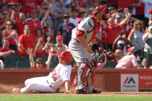 St. Louis Cardinals Aledmys Diaz slides past Cincinnati Reds catcher Devin Mesoraco with the game winning run on a double by Eric Fryer in the eighth inning at Busch Stadium in St. Louis on April 17, 2016. St. Louis won the game 4-3.  Photo by Bill Greenblatt/UPI