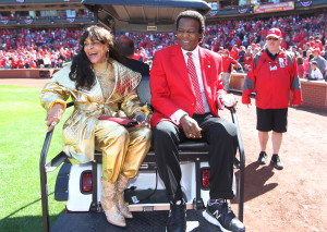 Former St. Louis Cardinals outfielder and member of the National Baseball Hall of Fame Lou Brock leaves the field with wife Jackie on a golf cart after Brock threw a ceremonial first pitch before a game against the Milwaukee Brewers on Opening Day at Busch Stadium in St. Louis on April 11, 2016. Brock had his left leg amputated from the knee down in November after complications from diabetes   Photo by Bill Greenblatt/UPI
