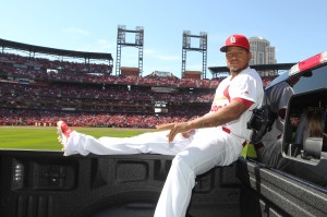 St. Louis Cardinals pitcher Carlos Martinez enjoys a ride in a pickup truck around the Busch Stadium track during player introductions on Opening Day before a game against the Milwaukee Brewers in St. Louis on April 11, 2016.   Photo by Bill Greenblatt/UPI
